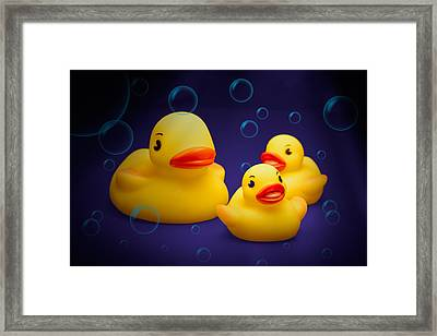 Rubber Duckies Framed Print by Tom Mc Nemar