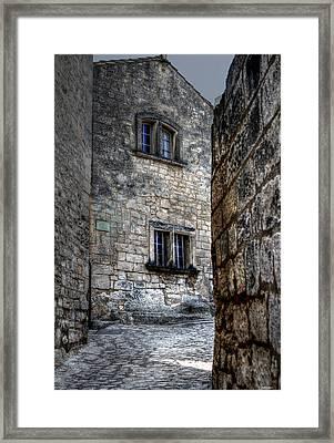 Rue Du Chateau Les Baux France Framed Print by Tom Prendergast