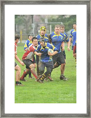Rugby In The Mud Framed Print by Rod Wiens