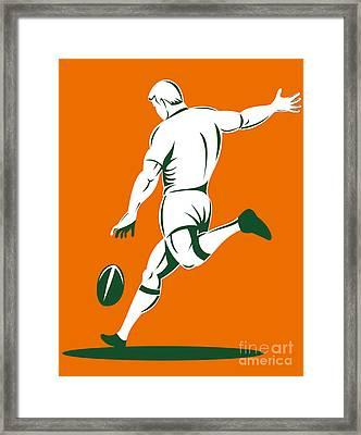 Rugby Player Kicking Framed Print by Aloysius Patrimonio