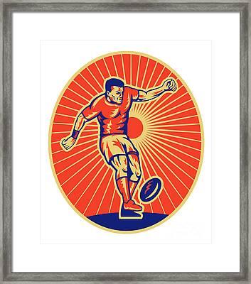 Rugby Player Kicking Ball Woodcut Framed Print by Aloysius Patrimonio
