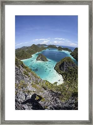 Rugged Limestone Islands Surround Framed Print by Ethan Daniels