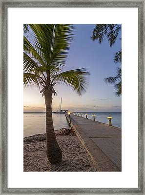 Rum Point Pier At Sunset Framed Print by Adam Romanowicz