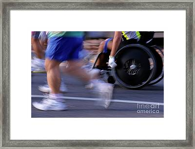 Runners And Disabled People In Wheelchairs Racing Together Framed Print by Sami Sarkis