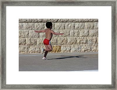 Framed Print featuring the photograph Running Child by Bruno Spagnolo