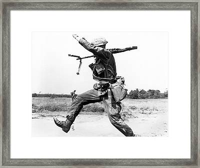 Running Soldier Framed Print by Underwood Archives