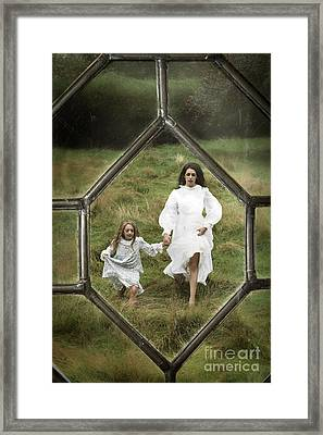 Running Woman And Child Framed Print