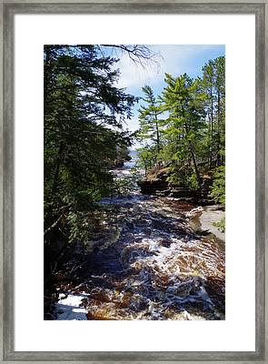 Rushing Stream Framed Print by John Adams