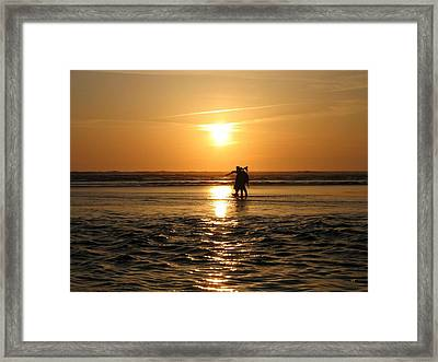 Rushing To Beat The Tide Framed Print