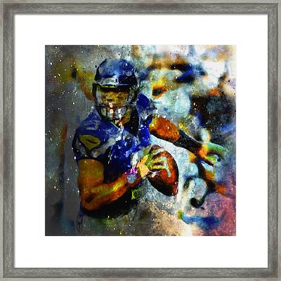 Russell Wilson On The Move 1a Framed Print by Brian Reaves