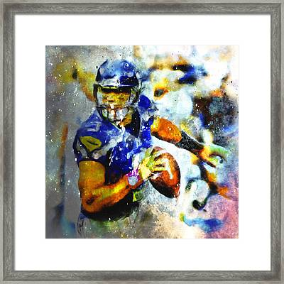 Russell Wilson On The Move 1b Framed Print by Brian Reaves