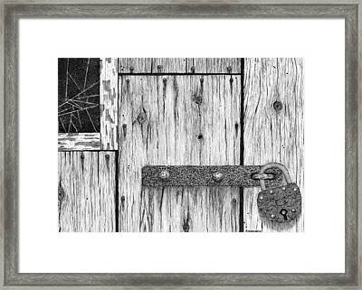 Rusted Lock And Cracked Window Framed Print by Ed Einboden