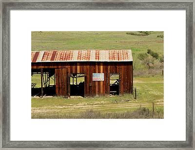 Framed Print featuring the photograph Rustic Barn With Flag by Art Block Collections