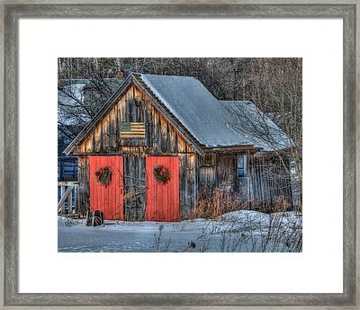 Rustic Barn With Flag In Snow Framed Print
