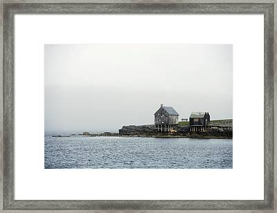 Rustic Cabin On Stilts On Rocky Shore Framed Print by Gillham Studios
