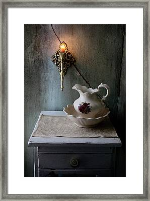 Rustic Water Closet With Brass Sconce And A Pretty Floral Patter Framed Print