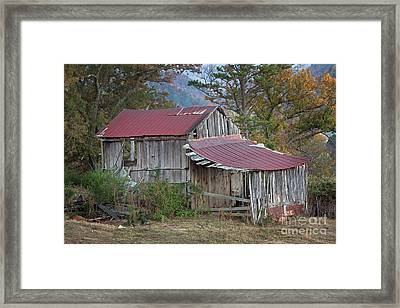 Rustic Weathered Hillside Barn Framed Print by John Stephens