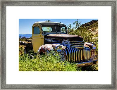 Rusting In The Weeds Framed Print by James Marvin Phelps