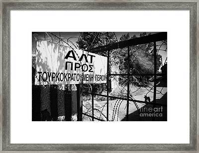 rusty fence and razor wire in UN buffer zone in the green line dividing north south cyprus Framed Print