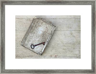 Framed Print featuring the photograph Rusty Key On The Old Tattered Book by Michal Boubin