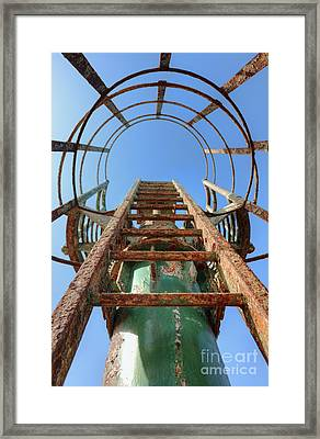 Rusty Ladder Framed Print by Noam Armonn
