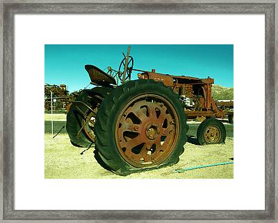 Rusty Old Tractor With A Flat Tire Framed Print