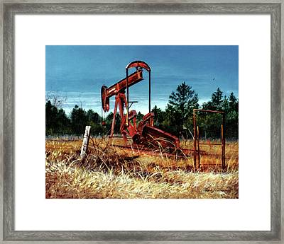 Rusty Pump Jack Framed Print
