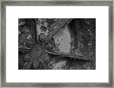 Rusty Wheel Framed Print by John Cox