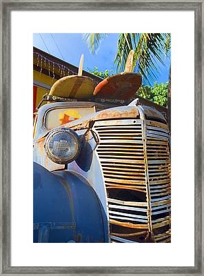 Saddeling Up Framed Print by Ron Regalado