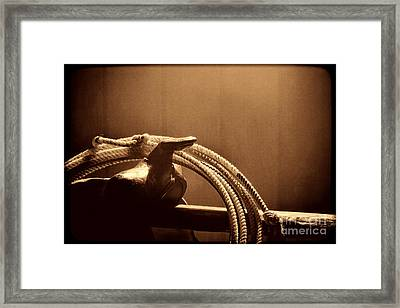 Saddle In A Barn Framed Print by American West Legend By Olivier Le Queinec