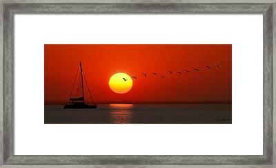 Framed Print featuring the photograph Sailboat At Sunset by Joe Bonita