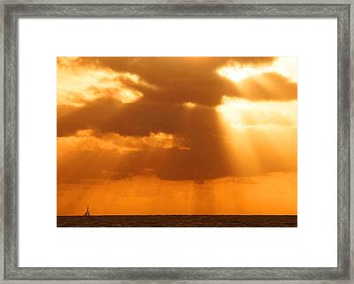 Sailboat Bathed In Hazy Rays Framed Print