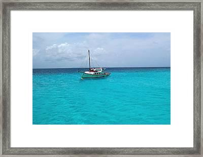 Sailboat Drifting In The Caribbean Azure Sea Framed Print by Amy McDaniel