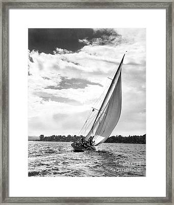 Sailboat Off Shore Framed Print by Ewing Galloway