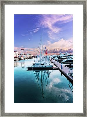 sailboats and yachts in the roads of the main sea channel of the Sochi seaport Framed Print