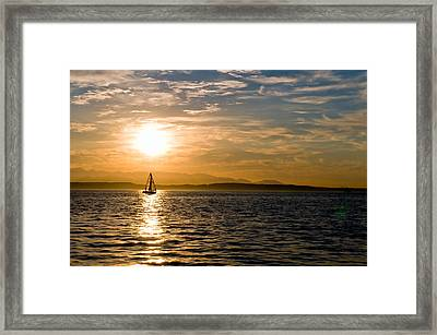 Sailing At Sunset Framed Print by Tom Dowd