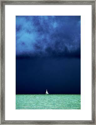 Sailing Beneath The Storm Framed Print by Vicki Jauron