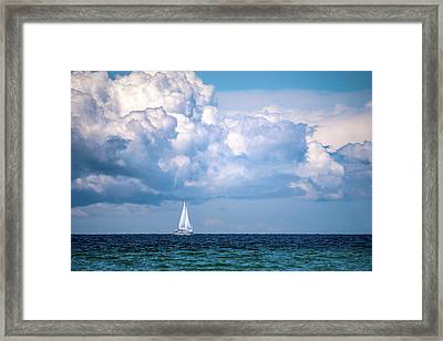 Sailing Under The Clouds Framed Print