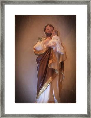 Saint Joseph Holding Baby Jesus Framed Print by Donna Kennedy