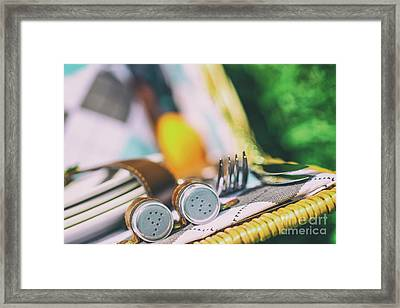Salt And Pepper With Cutlery In Picnic Basket Framed Print by Radu Bercan