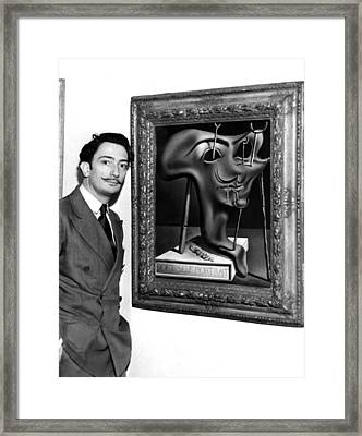 Salvador Dali, Showing Off His Piece Framed Print by Everett