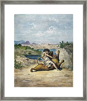 Samson Slaying A Lion Framed Print by Granger