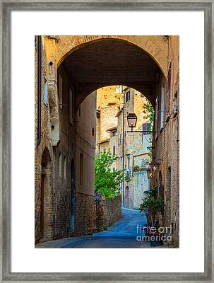 San Gimignano Archway Framed Print by Inge Johnsson