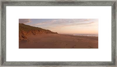Sand Dunes Along An Empty Beach Reflect Framed Print