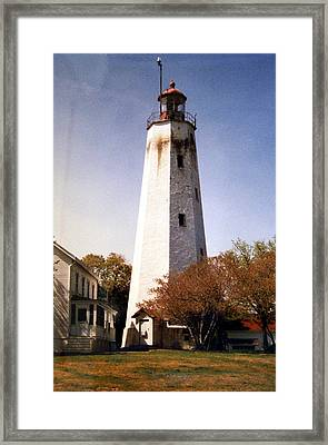 Framed Print featuring the photograph Sandy Hook Lighthouse by Frederic Kohli