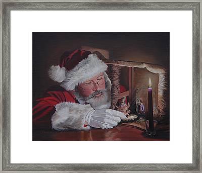 Santa At The Nativity Framed Print