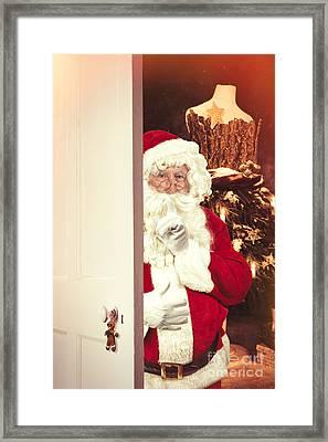 Santa Claus At Open Christmas Door Framed Print