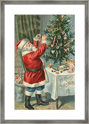 Santa Claus Decorating A Christmas Tree Framed Print by American School