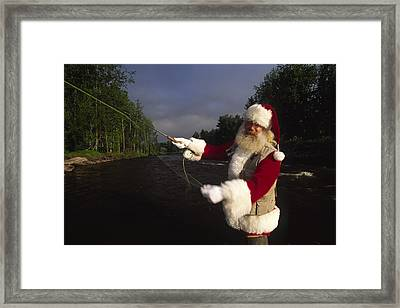 Santa Claus Fly Fishing Framed Print by Michael Melford