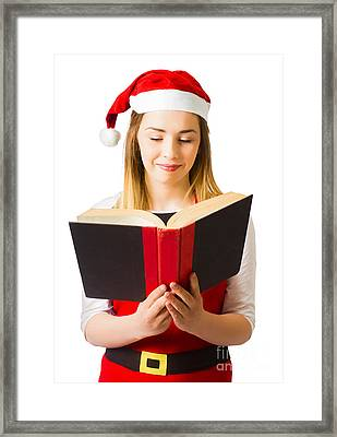 Santa Helper Reading Christmas Story Book Framed Print by Jorgo Photography - Wall Art Gallery